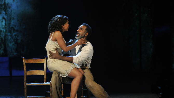 "Audra McDonald, left, and Norm Lewis perform in a scene from ""The Gershwins' Porgy and Bess"" at the 66th Annual Tony Awards on Sunday June 10, 2012, in New York. The production wona Tony Award for best revival of a musical.  (Photo by Charles Sykes /Invision/AP)"