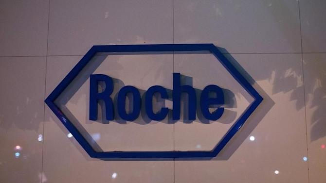 The logo of Swiss pharmaceutical company Roche is seen outside the Shanghai Roche Pharmaceutical Co. Ltd. headquarters in Shanghai