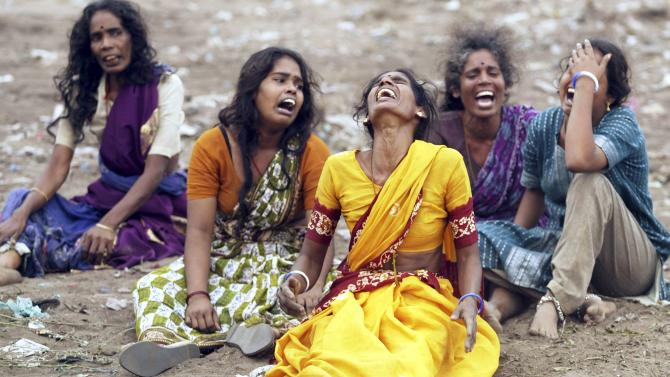 File photo of women mourning death of victims killed when tsunami hit in Cuddalore