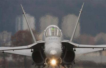 A Swiss Boeing F/A-18C rolls along the taxiway at the Swiss Army Airbase in Emmen, central Switzerland