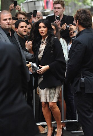 Australian fans try to take photos of American reality television celebrity Kim Kardashian as she arrives at the launch of her handbag fashion range in Sydney, Australia on Wednesday Nov. 2, 2011. (AP Photo/ Jeremy Piper)