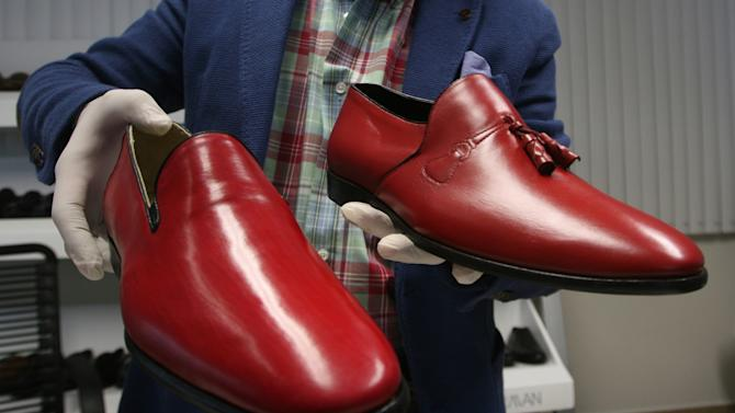 Armando Martin Duenas shows replicas of the two pairs of hand-crafted loafers that were given to Pope Benedict XVI during his March 2012 visit to Mexico at the Ackerman shoe factory in Leon, Mexico, Tuesday, Feb. 26, 2013. Benedict's title and what he will wear have been a major source of speculation since the 85-year-old pontiff stunned the world and announced he would resign Thursday, the first pope to do so in 600 years. (AP Photo/Alfredo Valadez)