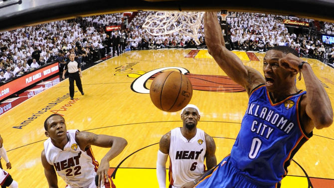 Oklahoma City Thunder point guard Russell Westbrook (0) dunks against the Miami Heat during the first half at Game 4 of the NBA Finals basketball series, Tuesday, June 19, 2012, in Miami.  (AP Photo/ Larry W. Smith, Pool)