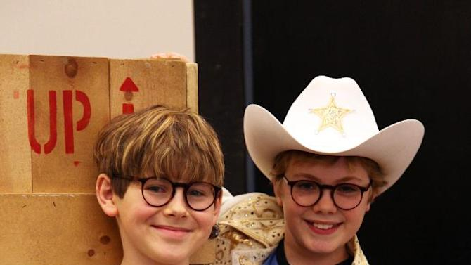 """In this Oct. 26, 2012, photo, Johnny Rabe, left, and Joe West pose during rehearsals for """"A Christmas Story, the Musical"""" in New York. Both boys are taking turns playing the bespectacled, daydreaming hero Ralphie, who desperately wants an air rifle as a Christmas gift. (AP Photo/Mark Kennedy)"""