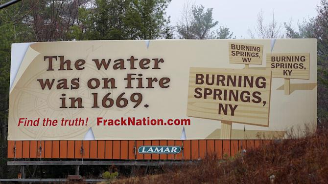In this photograph taken by AP Images for FrackNation, this new eye-opening billboard was unveiled today in natural-gas rich New York near the Pennsylvania border. The aggressive billboard shatters claims by environmentalists and anti-fracking filmmaker Josh Fox, that natural gas production has caused local tap water to become flammable. The billboard promotes the controversial documentary FrackNation, which is being called 'an answer to Gasland.' The