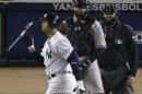 New York Yankees&#039; Alex Rodriguez, Left, Reacts After Striking Out With Two Runners On Base In The Eighth Inning Of Game 4 Of The American League Division Baseball Series Aganst The Baltimore Orioles, Thursday, Oct. 11, 2012, In New York. Orioles Catcher Matt Wieters, Center, Umpire Fieldin Culbreth, Right, Look On. (AP Photo/Peter Morgan)