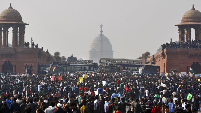 In this Dec. 22, 2012 file photo, protesters gather outside the Indian Presidential Palace during a protest against the brutal gang rape of a 23-year-old woman on a moving bus in New Delhi, India. Mukesh Singh, one among the four men sentenced to death for raping and killing the woman, says in a TV documentary being shown on March 8, 2015, that if their victim had not fought back she would not have been killed. (AP Photo/Tsering Topgyal, File)
