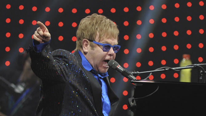 In this photo taken Sunday Nov. 25, 2012, pop icon Elton John performs during his concert in Beijing. John publicly dedicated his only concert in Beijing to Chinese artist and political critic Ai Weiwei, sending a murmur of shock through audience members accustomed to tight censorship of entertainment. (AP Photo) CHINA OUT