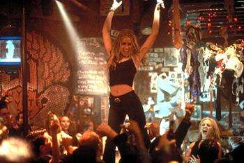 "Velvet-voiced, 21-year-old Violet Sanford ( Piper Perabo ) goes to New York to pursue her dream of becoming a songwriter, but her aspirations are sidelined by the notoriety she receives at her ""day"" job as a barmaid at the hottest spot in town, run by Lil ( Maria Bello , bottom right) in Touchstone's Coyote Ugly"