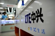 <p>A ZTE logo is seen on a sales counter in Wuhan, central China's Hubei province. Shares in Chinese telecom firm ZTE, accused by US lawmakers of posing a security threat, tumbled 15 percent in Hong Kong on Monday after it released a third-quarter profit warning.</p>