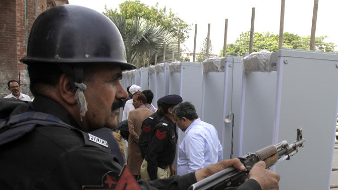 A Pakistani police officer is on alert at an entrance to the Gaddafi Stadium in Lahore, Pakistan, Sunday, May 24, 2015. The Twenty20 matches Friday and Sunday mark a return of international cricket to Pakistan for the first time since gunmen attacked buses carrying the Sri Lankan cricket team and match officials in this eastern city six years ago.  Security has been beefed up for the matches. (AP Photo/K.M. Chaudary)