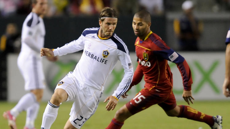 Los Angeles Galaxy midfielder David Beckham (23), of England, moves the ball past Real Salt Lake forward Alvaro Saborio (15) during an MLS soccer match, Saturday, Oct. 1, 2011, in Carson, Calif. (AP Photo/Gus Ruelas)