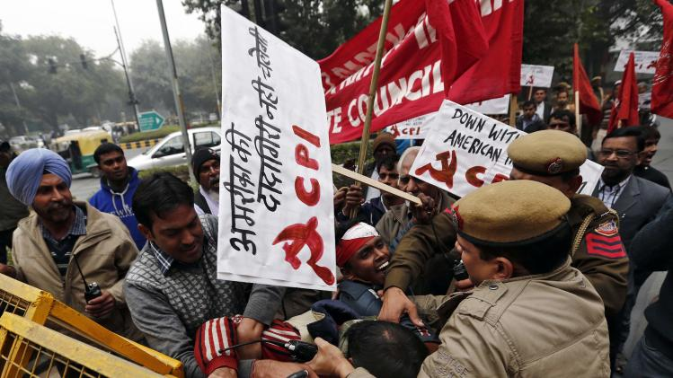 Supporters of CPI scuffle with Indian policemen during a protest near the American Center in New Delhi