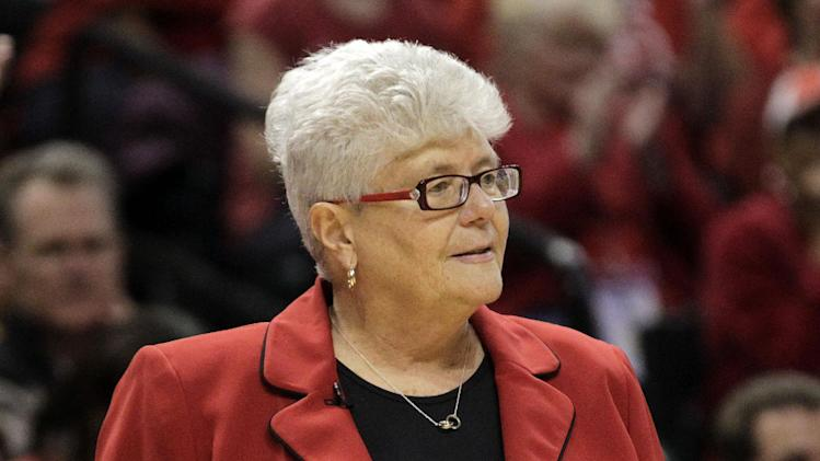Indiana Fever head coach Lin Dunn holds the ball after a stop in action while playing the Minnesota Lynx in the second half of Game 3 of the WNBA basketball Finals, Friday, Oct. 19, 2012, in Indianapolis. The Fever won 76-59. (AP Photo/AJ Mast)