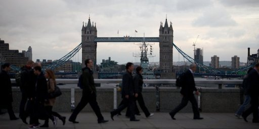 <p>People walk past London Bridge as they leave work in the City in central London. The Bank of England was expected to announce a pause to its economic stimulus programme on Thursday after recent official data showed Britain had exited a deep recession in the third quarter of 2012.</p>
