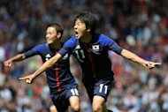 Japan&#39;s Kensuke Nagai (R) celebrates scoring during the London 2012 Olympic men&#39;s football quarter final match between Japan and Egypt at Old Trafford in Manchester, north-west England. Japan won 3-0
