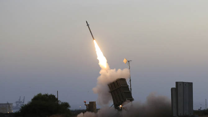 """An Iron Dome air defense system fires to intercept a rocket from Gaza Strip in the costal city of Ashkelon, Israel, Saturday, July 5, 2014. The Israeli military said its """"Iron Dome"""" defense system intercepted the rockets that were aimed at Beersheba. The military also said at least 29 other rockets and mortars were fired from the Gaza Strip at Israel over the weekend. It said it had retaliated with airstrikes on militant sites in Gaza. (AP Photo/Tsafrir Abayov)"""