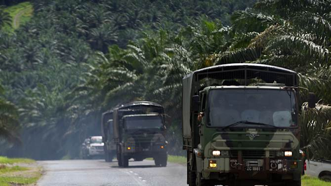Army truck advance on a road at Lahad Datu, Sabab, Malaysia on Sunday, March 3, 2013. Gunmen ambushed and killed five Malaysian policemen as fears mounted that armed intruders from the southern Philippines had slipped into at least three coastal districts on Borneo island, officials said Sunday. (AP Photo) MALAYSIA OUT