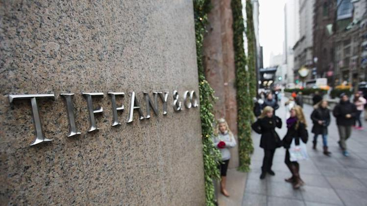 Pedestrians walk past the Tiffany's store in New York