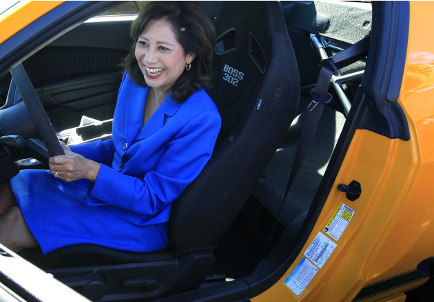 U.S. Secretary of Labor Hilda Solis smiles as she hears the engine of a 2013 Boss 302 Mustang at the Flat Rock Assembly in Flat Rock, Mich., Monday, Sept. 10, 2012. The plant, formerly known as AutoAl