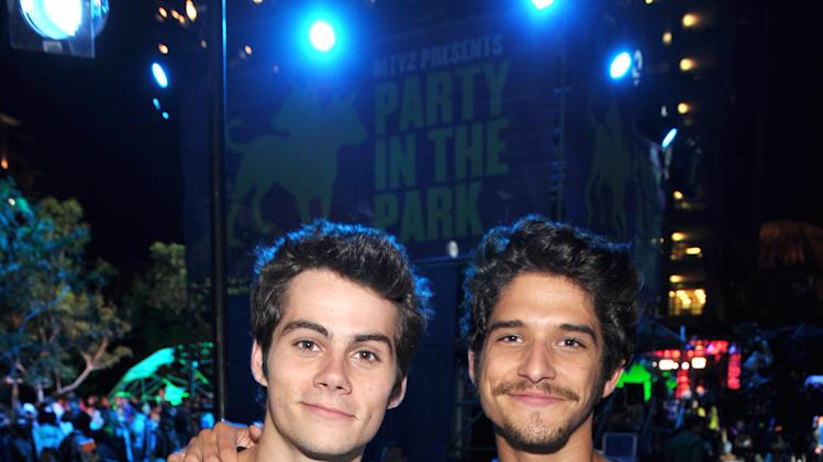 Dylan O'Brien, left, and Tyler Posey attend MTV2's Party in the Park on Day 2 of Comic-Con International on Thursday, July 18, 2013 in San Diego, Calif. (Photo by John Shearer/Invision for MTV2/AP Images)