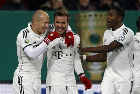 Bayern Munich's Robben, Goetze and Alaba celebrate goal against Augsburg during third round German soccer cup match in Augsburg