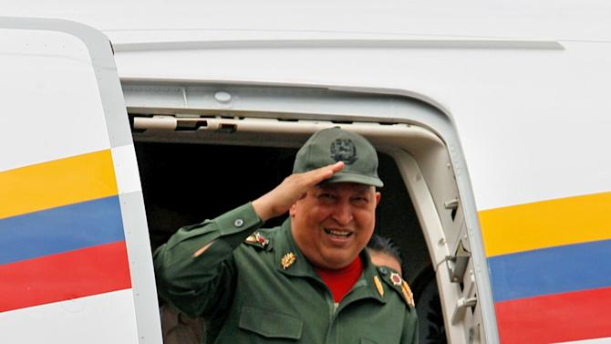 Venezuela's President Hugo Chavez greets supporters from a plane as he arrives to La Fria , Venezuela, Thursday Oct. 20, 2011.  Chavez said he is cancer-free because a series of medical exams in Cuba showed no recurrence of the illness following two months of chemotherapy treatments.  Chavez underwent surgery in Cuba in June to remove a cancerous tumor from his pelvic region. He has not revealed where the tumor was located nor the type of cancer with which he was diagnosed. (AP Photo/Fernando Llano)