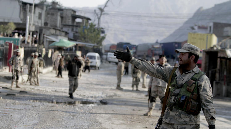 Afghan border police stand guard near the torkham border crossing