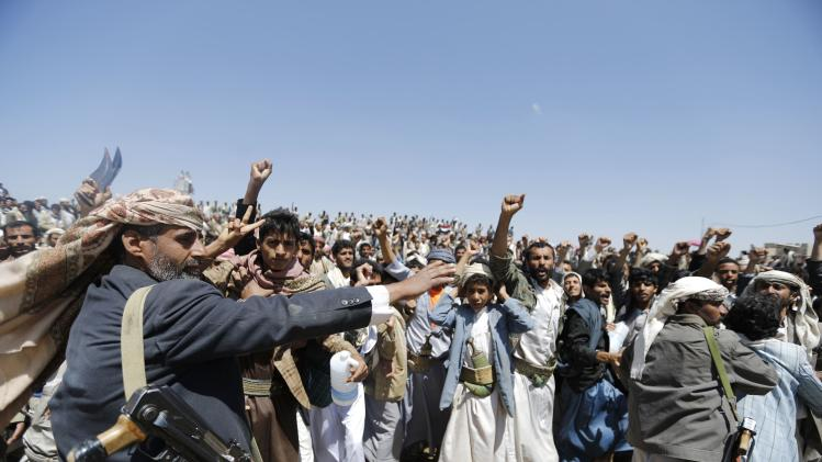 Followers of the Shi'ite Houthi group attend a gathering near Sanaa