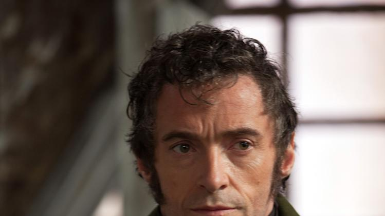 """FILE - This publicity file image released by Universal Pictures shows Hugh Jackman as Jean Valjean in a scene from """"Les Miserables.""""  The costumes for the film were designed by Spanish designer Paco Delgado. (AP Photo/Universal Pictures, Laurie Sparham, File)"""