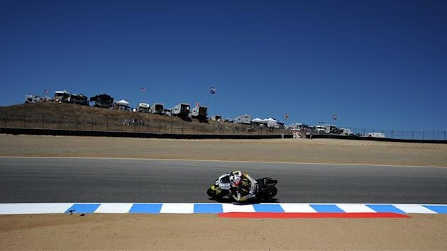 Ben Spies of the US steers his Monster Yamaha Tech 3 during the free pratice session of the US moto Grand Prix in Laguna Seca, California