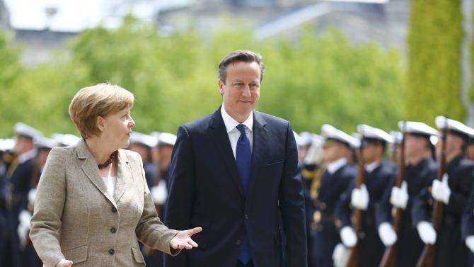 German Chancellor Merkel and Britian's Prime Minister Cameron in spect honour guard at Chancllery in Berlin