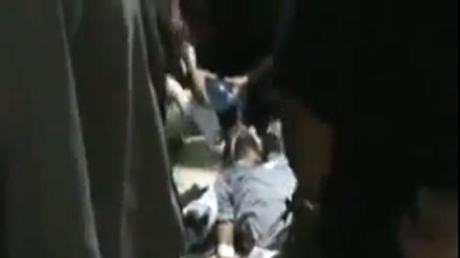 This image made from amateur video released by Shaam News Network and accessed Saturday, May 26, 2012 purports to show an injured Syrian in a hospital in Houla, Syria. Government troops shelled a string of villages in central Syria before pro-regime thugs swept through the area, shooting people in the streets and in their homes in attacks that killed more than 90 people, activists said Saturday. The assault on Houla, an area northwest of the central city of Homs, is one of the bloodiest single events in Syria's 15-month-old uprising. (AP Photo/Shaam News Network via AP video) TV OUT, THE ASSOCIATED PRESS CANNOT INDEPENDENTLY VERIFY THE CONTENT, DATE, LOCATION OR AUTHENTICITY OF THIS MATERIAL