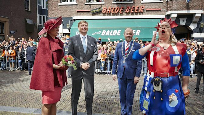 King Willem Alexander of the Netherlands (2nd L) and his wife Queen Maxima (L) take part in King's Day in Dordrecht, the Netherlands