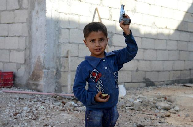 A Syrian boy holds a toy gun in the northern Syrian town of Atareb in the Aleppo province on November 7, 2012. More than 37,000 people have been killed since the outbreak of Syria's anti-regime revolt