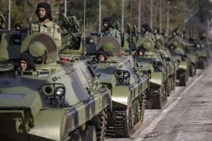 Serbian army soldiers drive tanks during preparations for a military parade in Belgrade