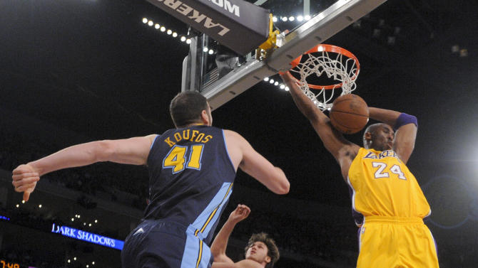 Los Angeles Lakers' Kobe Bryant, right, scores as Denver Nuggets' Kosta Koufos looks on during the first half of a NBA first-round playoff basketball game in Los Angeles, Tuesday, May 1, 2012. (AP Photo/Chris Carlson)