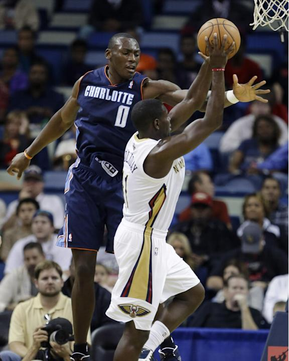 New Orleans Pelicans guard Tyreke Evans (1) drives to the basket against Charlotte Bobcats forward Bismack Biyombo (0) in the first half of an NBA basketball game in New Orleans, Saturday, Nov. 2, 201