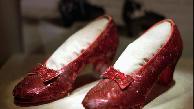 "FILE - In this April 10, 1996 file photo, the ruby slippers worn by Judy Garland in the 1939 film ""The Wizard of Oz"" are shown on display during a media tour of the ""America's Smithsonian"" exhibition in Kansas City, Mo.   The ruby slippers are leaving the U.S.  on their first international journey to London's Victoria and Albert Museum.  (AP Photo/Ed Zurga)"