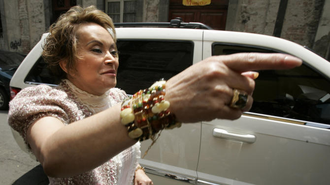 FILE - In this Friday July 14, 2006 file photo, teachers' union head Elba Esther Gordillo gestures as she arrives to attend a meeting with education workers a day after being expelled from Mexico's Institutional Revolutionary Party in Mexico City. Gordillo, the head of Mexico's powerful teachers' union, was arrested at an airport outside Mexico City on Tuesday, Feb. 26, 2013, for alleged embezzlement, with federal officials accusing her using union funds to pay for plastic surgery, buy a private plane and even pay her bill at Neiman Marcus. (AP Photo/Dario Lopez-Mills, file)