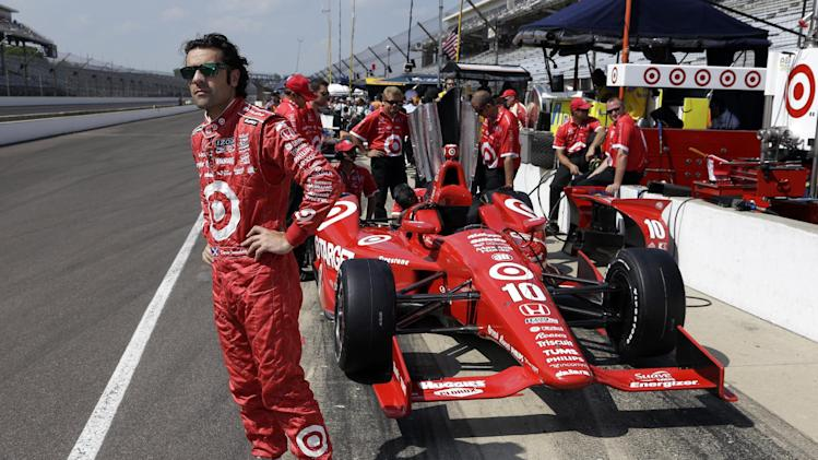 Dario Franchitti, of Scotland, waits next to his car during a break in a practice session on the second day of qualifications for the Indianapolis 500 auto race at the Indianapolis Motor Speedway in Indianapolis Sunday, May 19, 2013. (AP Photo/Tom Strattman)
