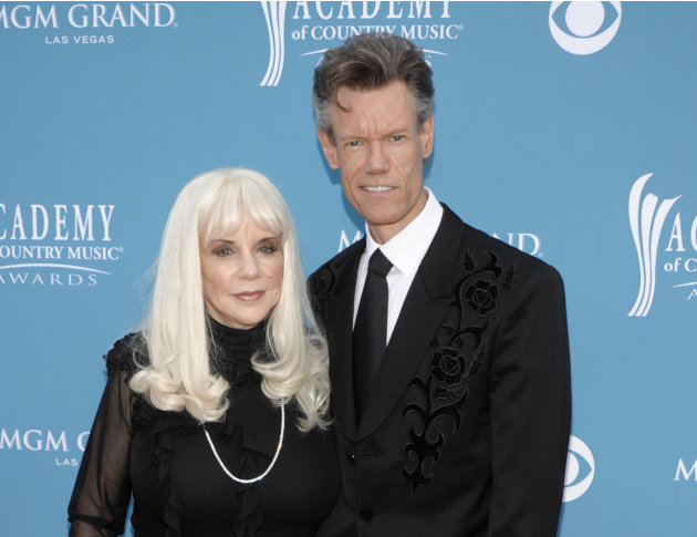 FILE - In this April 18, 2010 file photo, country singer Randy Travis, right, and then wife Elizabeth arrive at the 45th Annual Academy of Country Music Awards in Las Vegas. Travis has filed a counter