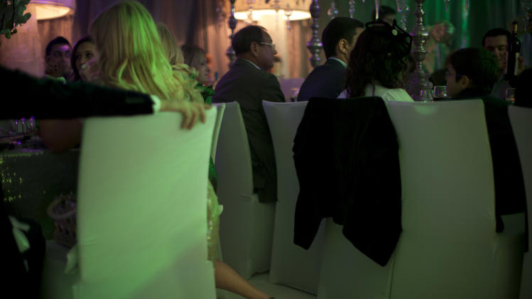 In this Dec. 31, 2011 photo, people attend a New Year's party catering to the upper crust of Israel's Russian-speaking immigrant community, in Tel Aviv, Israel. (AP Photo/Oded Balilty)