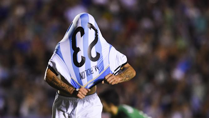 Argentina's Maximiliano Brian Rolon removes his shirt to celebrate his goal against Brazil at a South America Under-20 soccer match in Montevideo, Uruguay, Sunday, Feb. 1, 2015. (AP Photo/Matilde Campodonico)