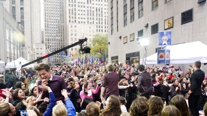 """One Direction member Louis Tomlinson, left, performs on NBC's """"Today"""" show on Tuesday, Nov. 13, 2012 in New York. (Photo by Charles Sykes/Invision/AP)"""