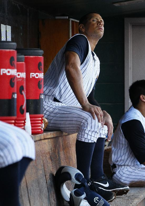 New York Yankees' Alex Rodriguez looks out from the dugout during a Class AA baseball game with the Trenton Thunder against the Reading Phillies, Friday, Aug. 2, 2013, in Trenton, N.J. (AP Photo/Tom Mihalek)