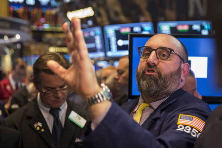 Wall St. ends down after weak economic data but gains in May