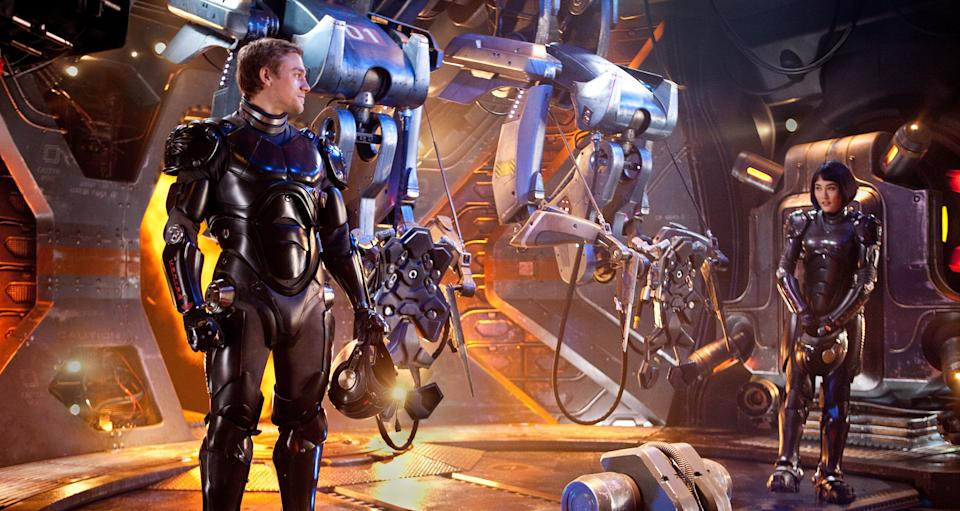 "This film image released by Warner Bros. Pictures shows Charlie Hunnam as Raleigh Becket, left, and Rinko Kikuchi as Mako Mori in a scene from ""Pacific Rim."" (AP Photo/Warner Bros. Pictures, Kerry Hayes)"