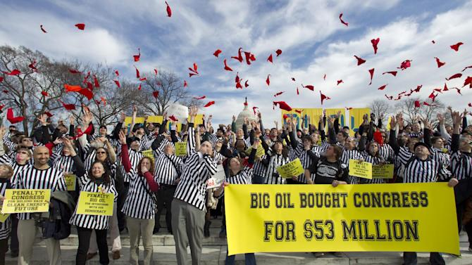 FILE - In this Jan. 24, 2012 file photo, protestors against the Keystone XL pipeline dressed as referees throw red penalty flags during a rally on Capitol Hill in Washington. Embarking on a second term, President Barack Obama faces mounting pressure on a decision he had put off during his re-election campaign: whether to approve the $7 billion proposed Keystone XL oil pipeline between the U.S. and Canada.  (AP Photo/Manuel Balce Ceneta, File)