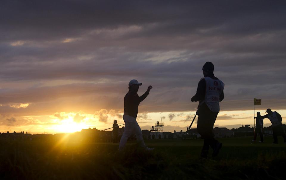 Korea's Jiyai Shin, centre, waves on the 18th green as she wins the Women's British Open golf championships at Royal Liverpool Golf Club, Hoylake, England, Sunday Sept. 16, 2012.  (AP Photo/Jon Super)